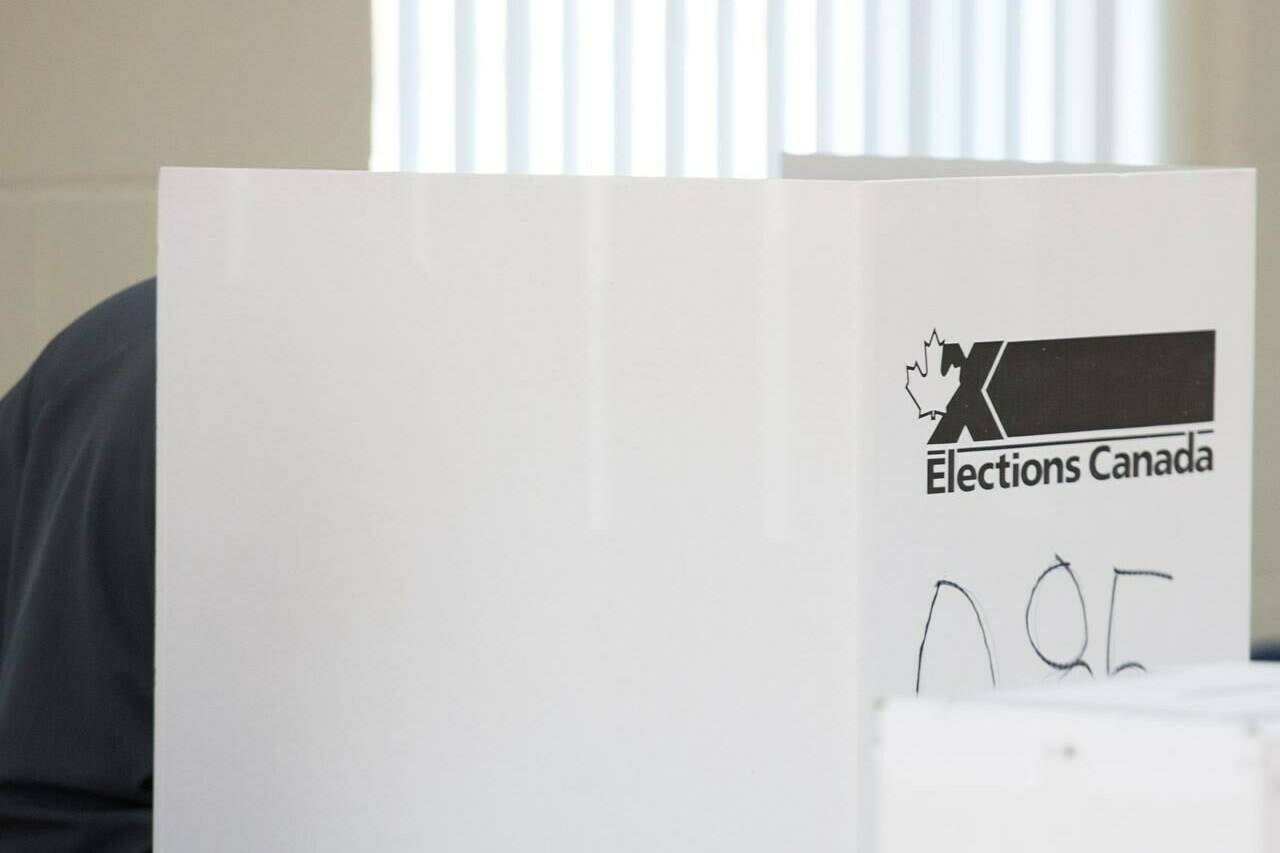 A man casts his ballot at a polling station on federal election day in Shawinigan, Que., Monday, Oct. 21, 2019. THE CANADIAN PRESS/Graham Hughes