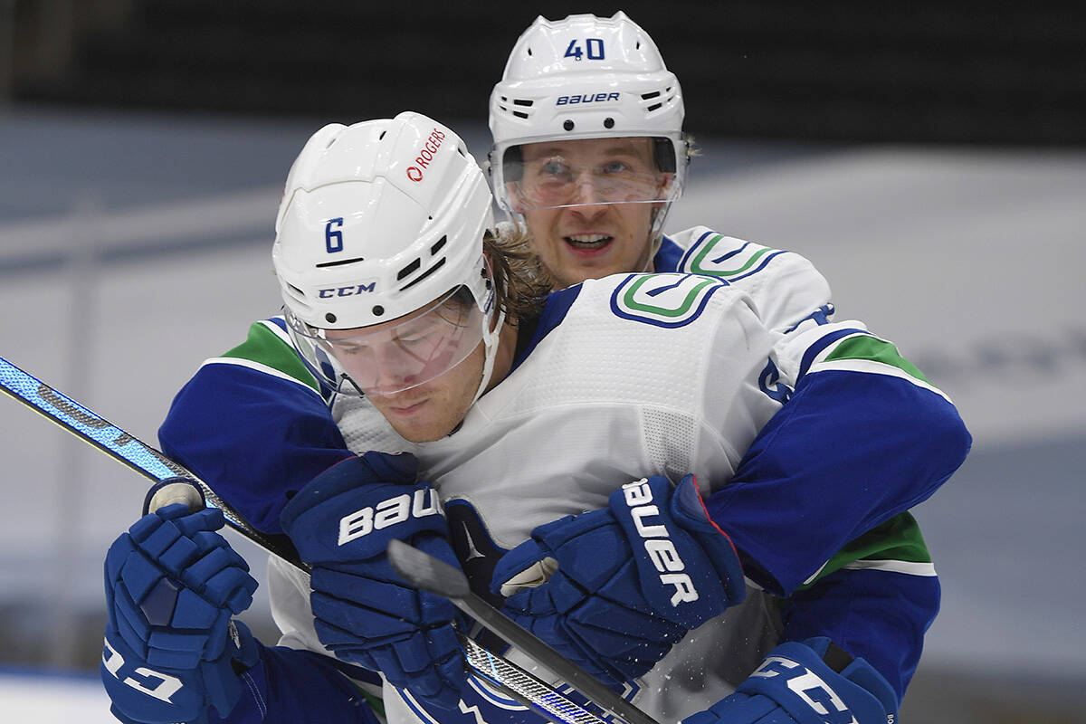 Vancouver Canucks players Brock Boeser (6) and Elias Pettersson (40). THE CANADIAN PRESS/Dale MacMillan