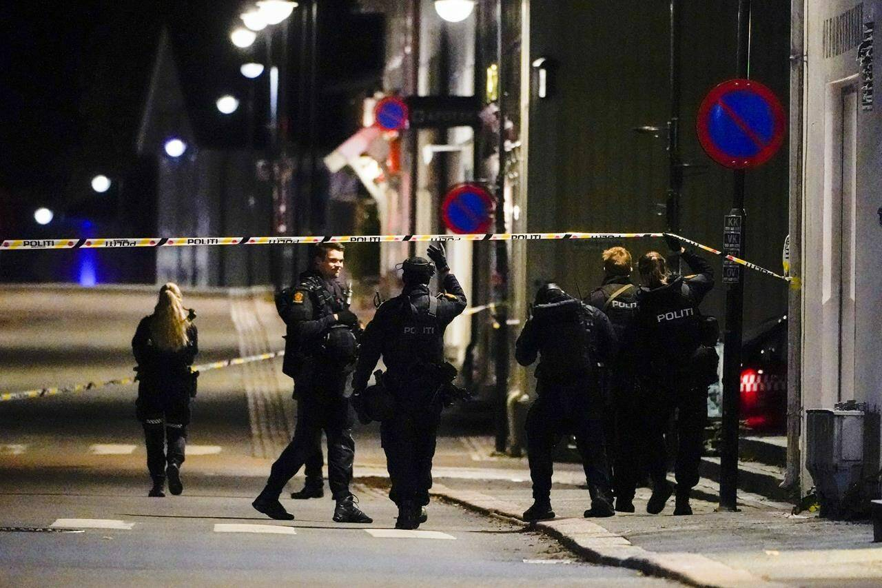 Police at the scene after an attack in Kongsberg, Norway, Wednesday, Oct. 13, 2021. Several people have been killed and others injured by a man armed with a bow and arrow in a town west of the Norwegian capital, Oslo. (Hakon Mosvold Larsen/NTB Scanpix via AP)