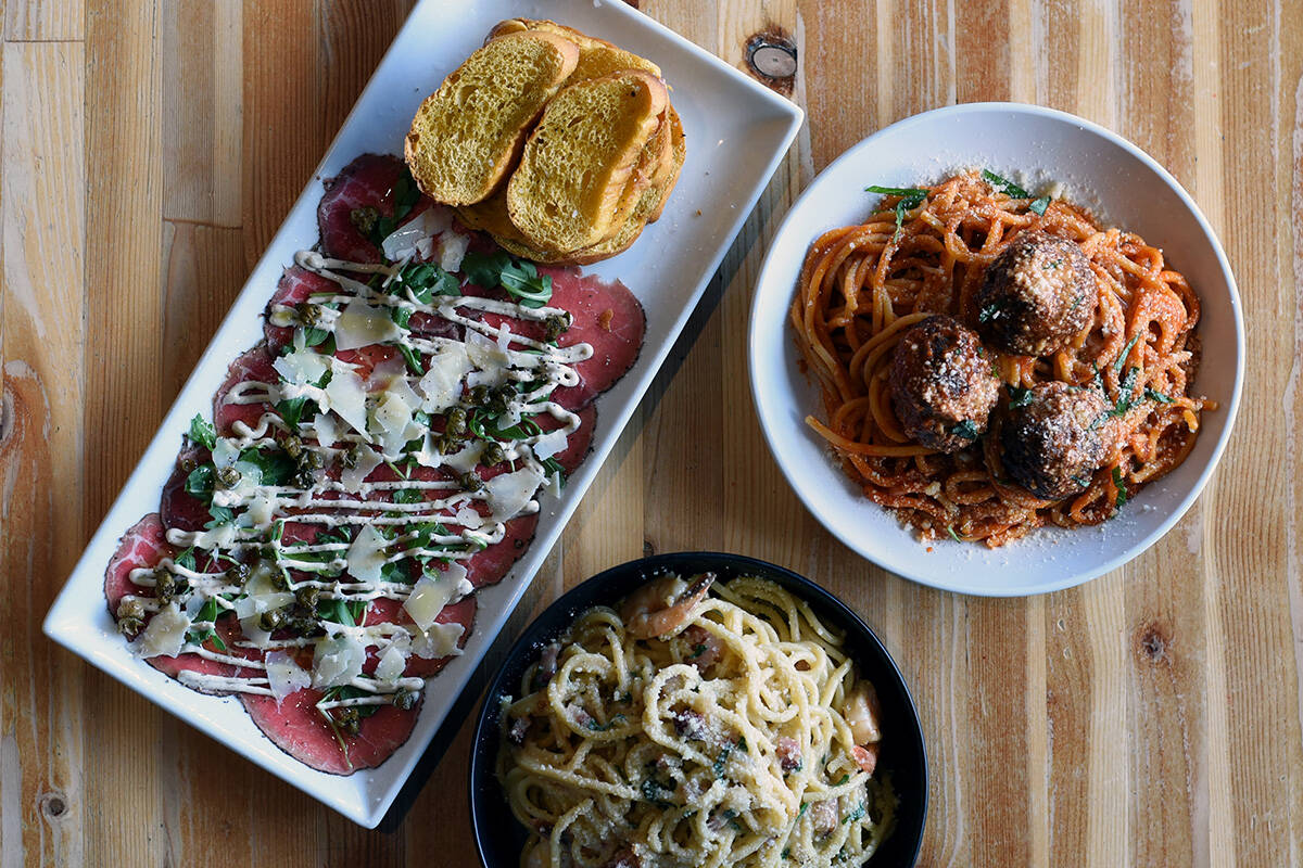 September 8, 2021 -Dishes of ( from top left, clockwise) Beef Carpaccio, Spaghetti and Wagyu Meatballs  and Prawn Carbonara at the Lot 1 Pasta Bar restaurant. Don Denton photograph