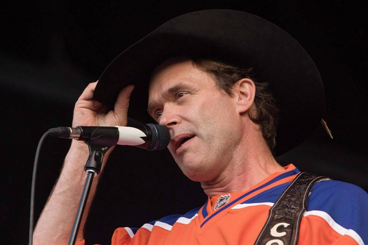 Corb Lund tips his hat during Fire Aid for Fort McMurray concert in Edmonton on Wednesday, June 29, 2016. THE CANADIAN PRESS/Amber Bracken