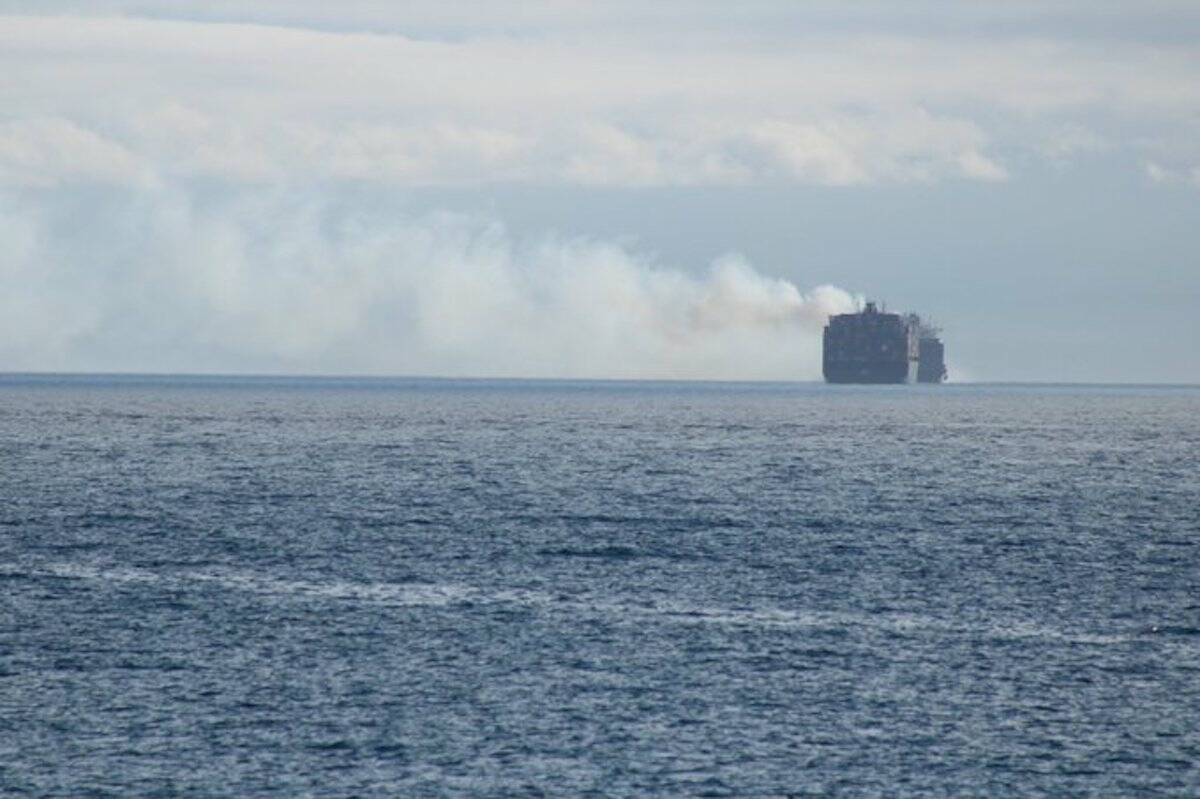 Smoke coming off MV Zim Kingston vessel can be seen from Victoria. (Jake Romphf/News Staff)