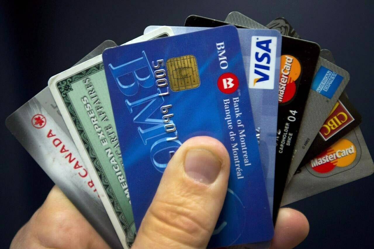 Credit cards are displayed in Montreal, Wednesday, Dec. 12, 2012. If you haven't shopped for a credit card in a while, you may see some unfamiliar names in the offerings. THE CANADIAN PRESS/Ryan Remiorz