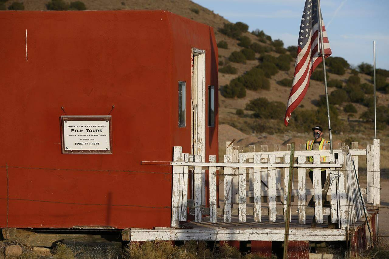 A sign offering film tours is seen at the entrance of the Bonanza Creek Film Ranch in Santa Fe, N.M. Friday, Oct. 22, 2021. Actor Alec Baldwin fired a prop gun on the set of a Western being filmed at the ranch on Thursday, Oct. 21, killing the cinematographer, officials said. The director of the movie was wounded, and authorities were investigating. (AP Photo/Andres Leighton)