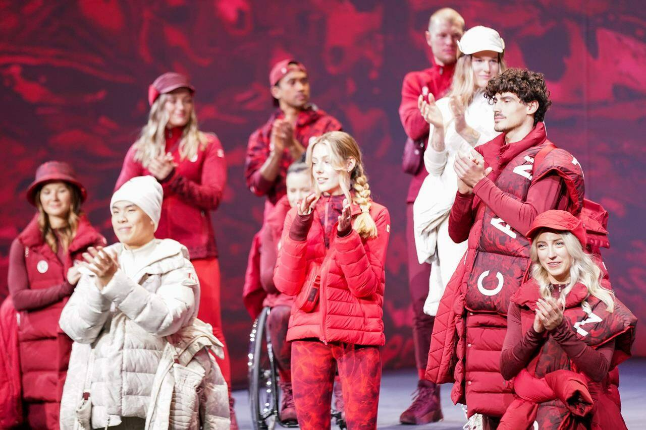 Canadian Olympians and Paralympians gather on stage at the Team Canada x Lululemon Athlete Kit Reveal in Toronto on Tuesday, October 26, 2021. Lululemon will outfit Canada's Olympic and Paralympic athletes starting with the upcoming Winter Games in Beijing. THE CANADIAN PRESS/Evan Buhler