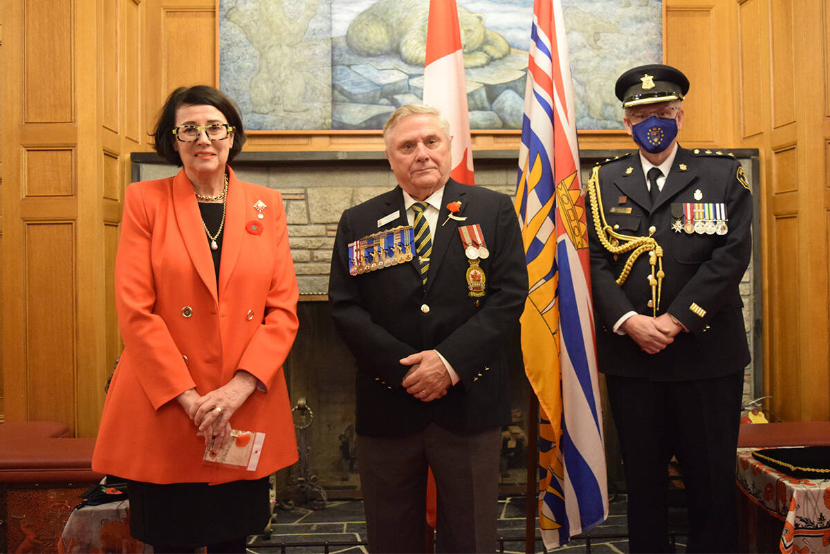 Lt.-Gov. Janet Austin, Royal Canadian Legion BC and Yukon commander Angus Stanfield and temporary aide-de-camp to the Lt.-Gov. Glen Greenhill at Rockland Avenue's Government House, Oct. 26. (Kiernan Green/News Staff)